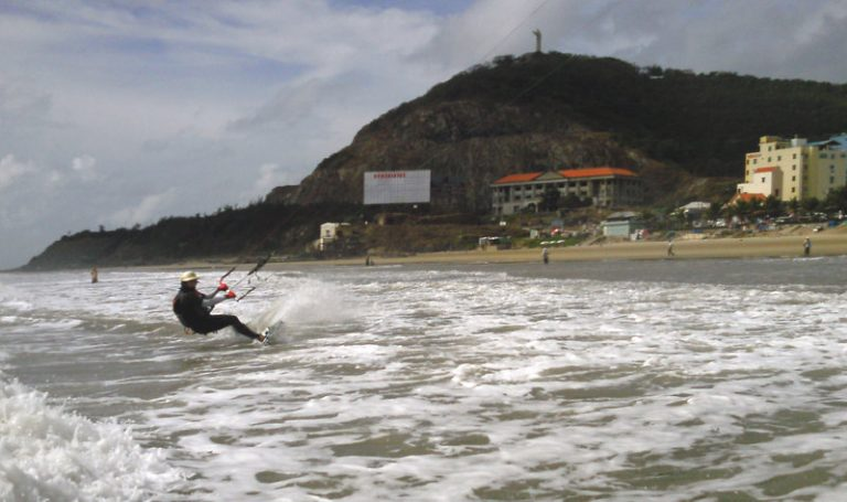9 kitesurfing in Vung Tau beach with the Christ statue up there