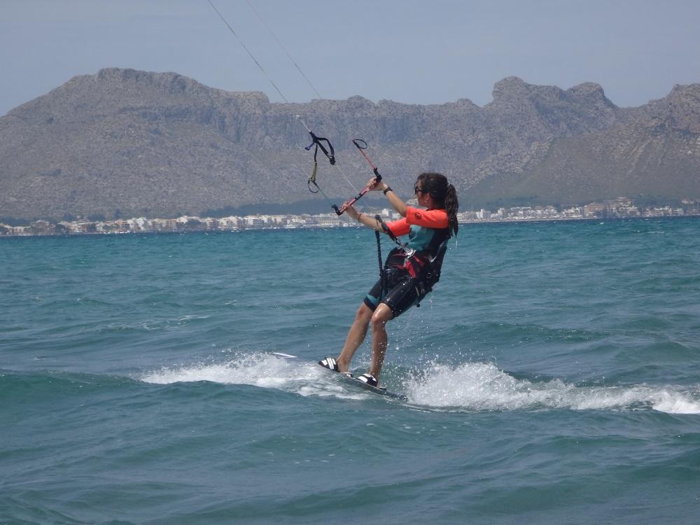 9-Marta-gaining-speed-kitesurfing-lessons-mallorca-kitesurfing mallorca-com